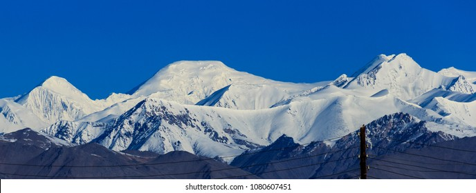 Ibn Sina (Avicenna) Peak, rises to 7,134 metres (23,406 ft) in Gorno-Badakhshan. View from Karakul Village.
