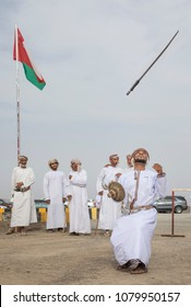 Ibri, Oman, 28th April 2018: man dancing and singing omani traditional way and throwing his sword up in a air