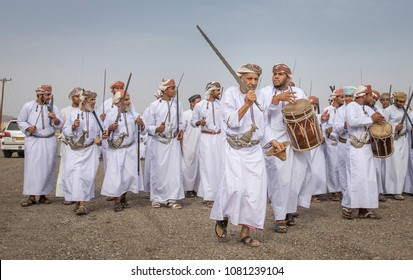 Ibri, oman, April 28th, 2018: omani men singing and dancing traditional way