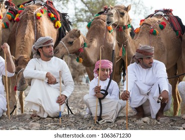 Ibri, Oman, April 7th, 2018: omani men waiting for a camel race at a countryside of rural Oman