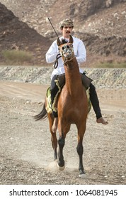 Ibri, Oman, April 7th, 2018: omani man on a horse in a countryside of Oman