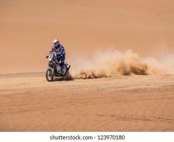 ICA, PERU - JAN. 06: Caspar Van Heertum (NLD) drive his bike during his participation on Rally Dakar 2013, JAN 06, 2013 in Ica, Peru.