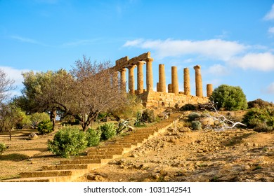 Icarus statue in front of Temple of Concordia at Agrigento Valley of the Temple, Sicily, Italy is a Greek temple of the ancient city of Akragas, located in the Valley of the Tem