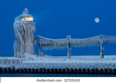 Ice accumulates on the St. Joseph North Pier Lighthouse at dusk in the Winter in Saint Joseph, Michigan on February 6, 2013