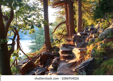 Ice age hiking trail and stone stairs in sunlight during sunset hours. Devil's Lake State Park, Baraboo area, Wisconsin, Midwest USA.