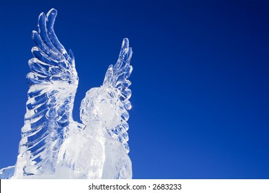 Ice angel looking ahead on a beautiful blue sky