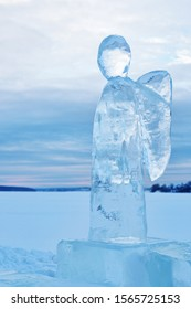 Ice angel in winter. Epiphany Orthodox holiday on a place of ice-hole swimming. Russia