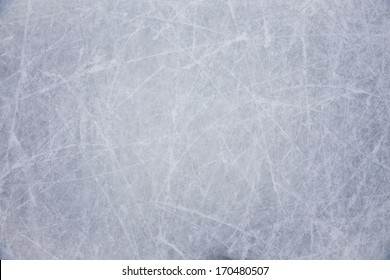 ice background with marks from skating and hockey, blue texture