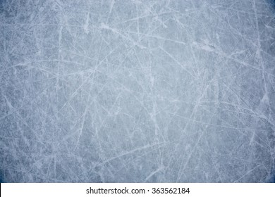 Ice background of skating and hockey scratches, blue texture of ice rink surface