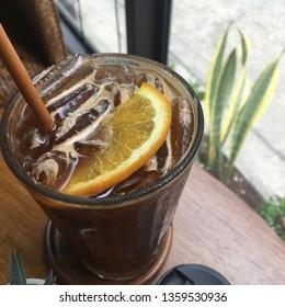 Ice black coffee served with yuzu orange slice and yuzu orange sauce. Resulting in a sweet and sour taste.