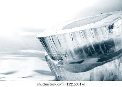 Ice Block / Ice is water frozen into a solid state. Depending on the presence of impurities. it can appear transparent or a more or less opaque bluish-white color.