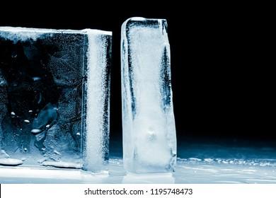 Ice blocks isolated on black background.