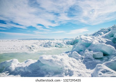 Ice blocks on the coast of the Sea of Okhotsk, Sakhalin Island, Russia. Crack and broken ice - the recent compression of ice