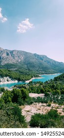 Ice blue lake between mountains