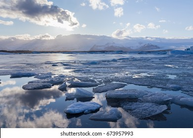 Ice breaking lake with sky reflection, Iceland winter season natural landscape background
