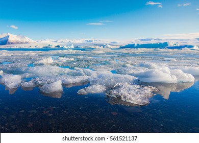 Ice breaking on Jakulsalon lake with blue sky background, Iceland winter natural landscape background