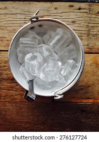 Ice bucket on wood table