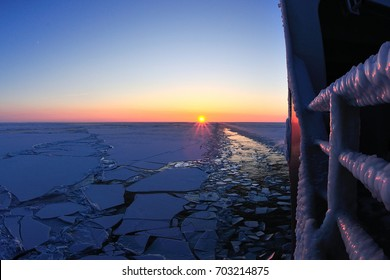 Ice canal form made by the ice class vessel at sunset
