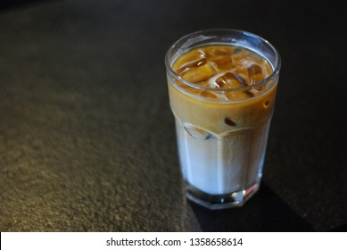 Ice Cappucino in dark solid background on selective focus