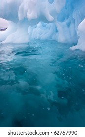 an ice cave carved by the sea in a giant iceberg