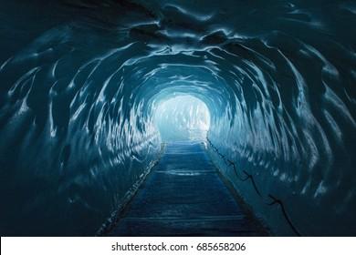 Ice cave Mer de Glace above french town Chamonix-Mont Blanc under Aiguille du Midi.