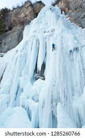 Ice climber ascending Stewart Falls outside of Provo, Utah, near Sundance Resort