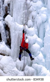 ice climber reaching for a higher ground