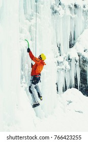 Ice climbing in the northern Caucasus. A man climbs the waterfall.