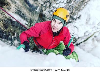 Ice climbing on a frozen waterfall.