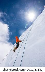Ice climbing on Ice wall in Tasman glacier of New Zealand