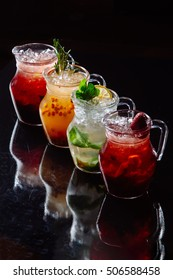 ice cocktails with fruit on dark background