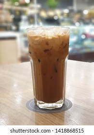 Ice coffee on a wooden table.  Cold coffee to drink during hot weather and help quench thirst.