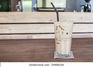 Ice coffee on the wooden table