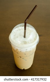 Ice coffee on wooden table