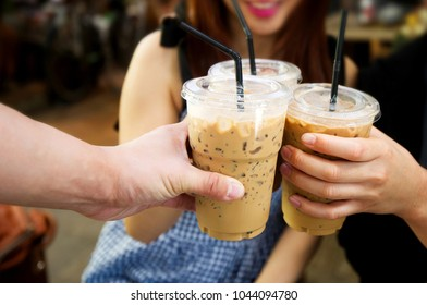 Ice coffee and people meeting friendship togetherness coffee shop concept.