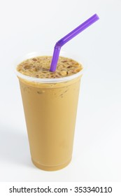 Ice coffee in plastic glass on white background