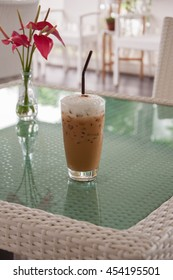 Ice Coffee with Red Flower. Ice Cappuccino in a glass.