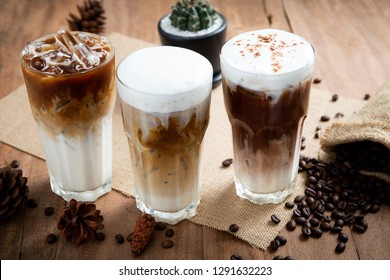 Ice coffee in a tall glass with coffee beans on the table. Latte, Cappuccino and Mocha.