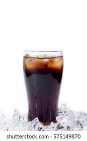 Ice cola with splashing, bubbles. Drink with ice