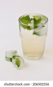 Ice cold drink with fresh herbs