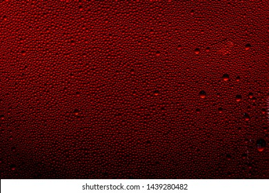 Ice cold glass fresh coca cola covered with water drops condensation Cold drink Drops of water cola drink background Raindrops texture Close up