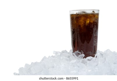 Ice cold soda sitting in a bed of ice, horizontal version, copy space to left