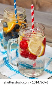 Ice cold sparkling water over ripe fresh fruit make for a healthy and thirst quenching beverage on a hot summer day.