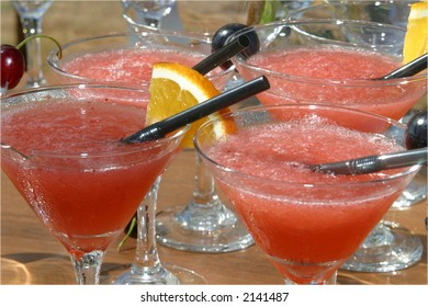 Ice cold watermelon margaritas in martini glasses