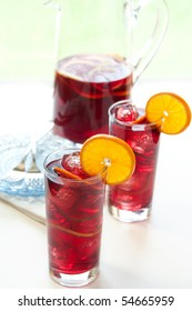 Ice cold wine drink with orange, lemon, and lime