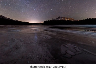 An ice covered lake near Banff National Park in Alberta, Canada on a cold winter night