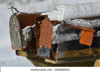 Ice Covered Old Rusty Rural Mailbox in Winter New Brunswick Canada