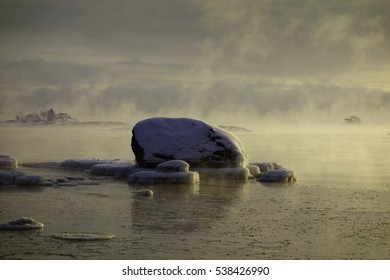 Ice covered rock in the Baltic Sea that about to freeze over in Helsinki, Finland on 6 January 2016