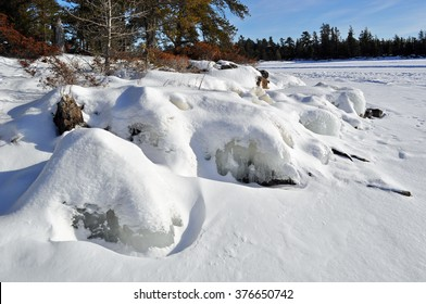 Ice Covered Rocks - Snow and Ice Covering Rocks - Rainy Lake, Minnesota