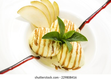ice cream with caramel sauce and mint on a white background